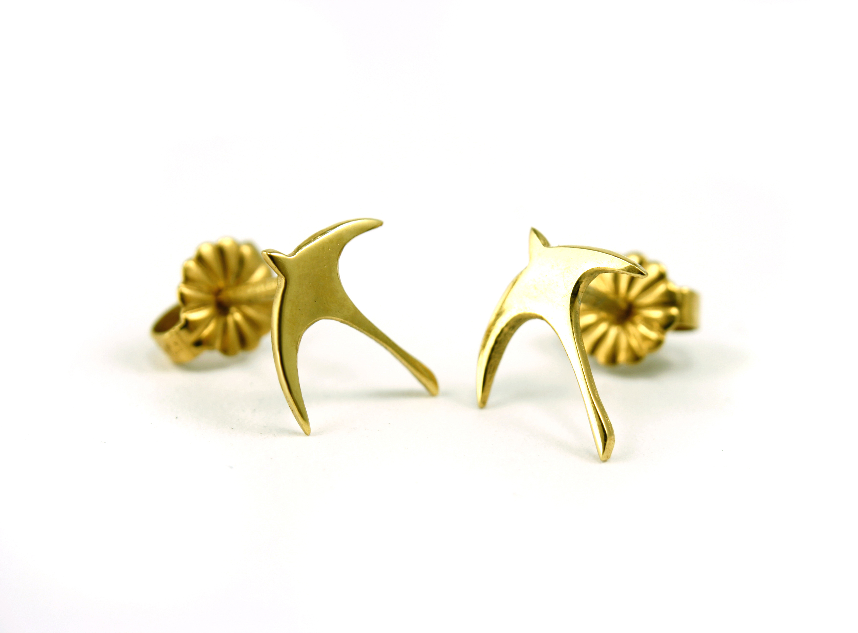 gold swallow studs